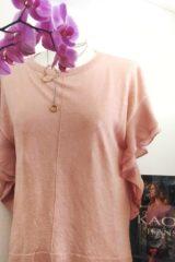 dettaglio maglia kaos rosa
